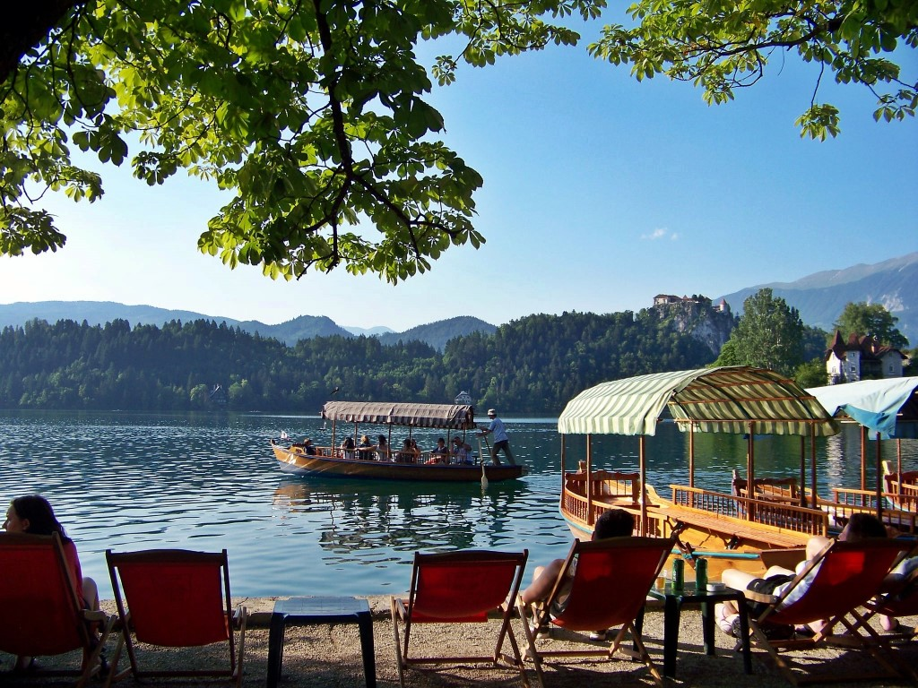 MaroWays Traditional pletna boat going to the island on the lake Bled